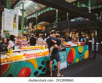 London, England -August 11th, 2018:: Father shopping with his child at the Borough Market, London at the beverage stand