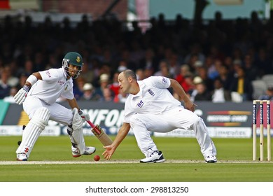 LONDON, ENGLAND. AUGUST 16 2012 England's Jonathan Trott fields as South Africa's Jean-Paul Duminy struggles in his crease during the third Investec  test match between England and South Africa