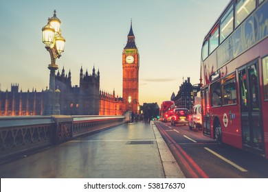 LONDON - ENGLAND  August 16, 2016: Tourists walking across westminster bridge, and a London bus driving past