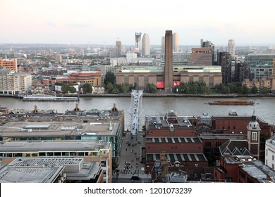 London England - August 16 2018: Aerial panorama of London taken at dusk from the Stone Gallery of St. Paul's Cathedral towards the River Thames showing Tate Modern Gallery and the Millenium Bridge