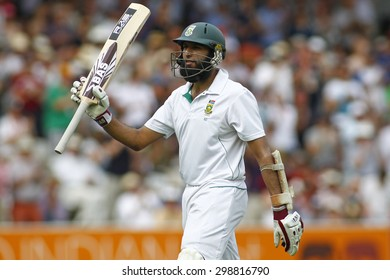 LONDON, ENGLAND. AUGUST 19 2012 South Africa's Hashim Amla walks off after being dismissed during the third Investec cricket  test match between England and South Africa, at Lords Cricket Ground