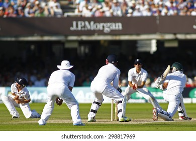 LONDON, ENGLAND. AUGUST 19 2012 South Africa's Imran Tahir sweeps the ball during the third Investec cricket  test match between England and South Africa, at Lords Cricket Ground