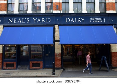 London, England - August 20, 2015: People at the entrance to Neal's Yard Dairy in Borough Market, London. The company started in 1979 and supplies cheeses made by farms across Britain and Ireland
