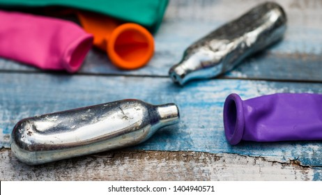 London, England - August, 2014: Nitrous Oxide Bulbs, Laughing Gas or Hippie Crack is used as a recreational drug and is not illegal for over 18's to use. Charities warn against using this legal high
