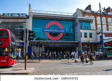 London / England - August 2019. Entrance to London Underground Brixton Station on a perfect summer day