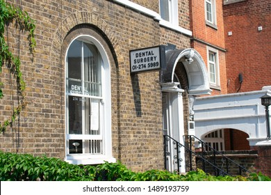 London / England - August 2019. Old Dental Surgery sign on a historic building in the London suburb of Brixton on a summer day