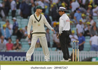 LONDON, ENGLAND - August 22 2013: Michael Clarke has a chat with umpire Aleem Dar after play finished on day two of the 5th Investec Ashes cricket match between England and Australia