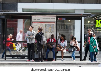 LONDON, ENGLAND - AUGUST 22, 2017 People are waiting for the bus at the bus stop. Representatives of different nationalities live in London