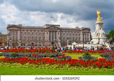 LONDON, ENGLAND - AUGUST 25, 2012: Buckingham Palace with Victoria Memorial and crowds of people