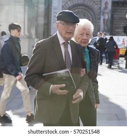 LONDON, ENGLAND - August 25 , 2016 Elderly couple walking on the street