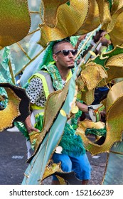 LONDON, ENGLAND - AUGUST 26: A street dancer in costume at Notting Hill Carnival on August 26, 2013 in London