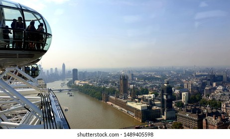 London, England, August 27th, 2019: Tourists enjoying the spectacular views along the River Thames on the London Eye ride.