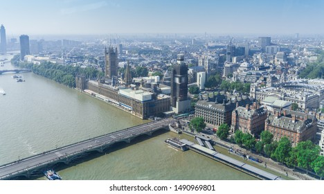 London, England, August 27th, 2019:  view of London with Westminster Bridge, Palace of Westminster and Big Ben being renovated in the distance.