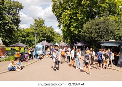 LONDON, ENGLAND - AUGUST 6; Crowd flocks to Victoria Park Saturday Market in lovely summer day to socialise and buy produce and food,August 6, 2017  London, England.