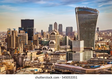 London, England - Bank district and Canary Wharf, the two leading financial districts of the world in central London with famous skyscrapers and other landmarks at golden hour