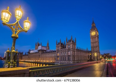 London, England - The Big Ben and the Houses of Parliament with street lamp taken from westminster bridge at dusk