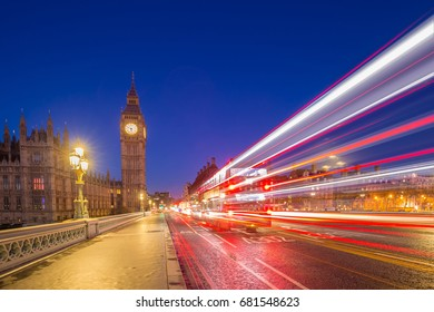 London, England - Big Ben and Houses of Parliament taken from the middle of Westminster Bridge at dusk with the lights of cars and buses passing by
