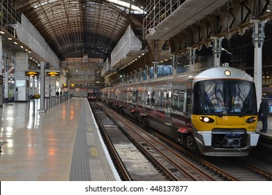 London England circa 2015; Paddington train station  with Heathrow Express train waiting on one of the platforms.