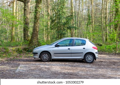 London, England - Circa April, 2016: A 2001 Peugeot 206 in the woods. The 206 is a supermini car produced by the French manufacturer Peugeot from May 1998 to the present day.