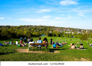 London, England - Circa April 2017: A sunny London day as people gather on Hampstead Heath.