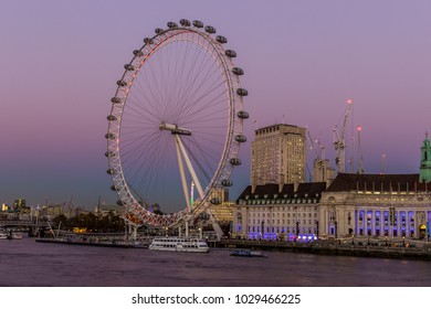 London / England - December 02 2016: London Eye lit with first night lights