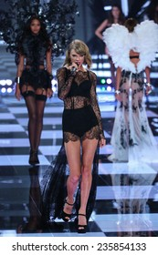 LONDON, ENGLAND - DECEMBER 02: Singer Taylor Swift performs during the 2014 Victoria's Secret Fashion Show on December 2, 2014 in London, England.