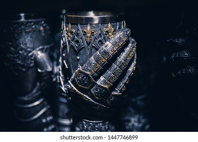 LONDON, ENGLAND, DECEMBER 10th, 2018: Lion heart gauntlet goblet, at the giftshop of White Tower. Photo with a shallow depth of field of a hand mixing and holding the goblet.