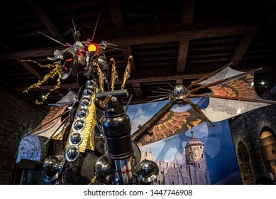 LONDON, ENGLAND, DECEMBER 10th, 2018: dragon statue titled Keeper installed at the entrance to exhibition Power House, Crown, People and Tower inside the White Tower building at the Tower of London.