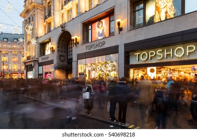 LONDON, ENGLAND - DECEMBER 17: Lots of Christmas shoppers outside Topshop, Oxford Street. In London, England. On 17th December 2016.