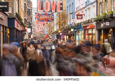 LONDON, ENGLAND - DECEMBER 17: Lots of people Christmas shopping on Carnaby Street, London. In London, England. On 17th December 2016.