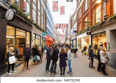 LONDON, ENGLAND - DECEMBER 17: People Christmas shopping on Carnaby Street, London. In London, England. On 17th December 2016.
