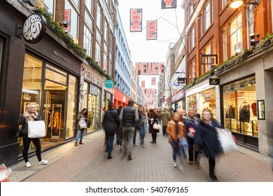 LONDON, ENGLAND - DECEMBER 17: People Christmas shopping in motion blur on Carnaby Street, London. In London, England. On 17th December 2016.