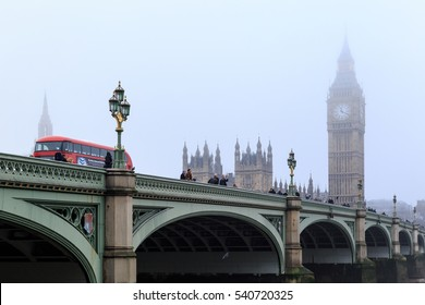 LONDON, ENGLAND - DECEMBER 17: Red London bus passes over Westminster Bridge. In London, England. On 17th December 2016.