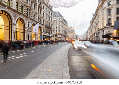 LONDON, ENGLAND - DECEMBER 17: Tourists and traffic on Regent Street. In London, England. On 17th December 2016.