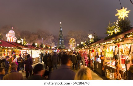 LONDON, ENGLAND - December 18, 2016: People walking in the Christmas markt of the Hyde Park's winter WonderLand park. The park 10th edition includes shows, live bands, markets and attractions.