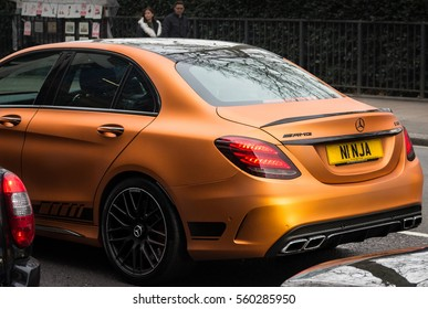 "LONDON, ENGLAND - DECEMBER 18, 2016: A Mercedes Benz AMG C class with custom ""NINJA"" number plates in traffic."