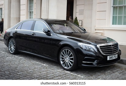 LONDON, ENGLAND - DECEMBER 18, 2016: A black Mercedes Benz S class parked outside a hotel.
