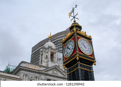 London, England - December 18, 2018 - Little Ben is a cast iron miniature clock tower that mimics Big Ben clock tower with Anna Pavlova Statue atop Victoria Palace Theatre.
