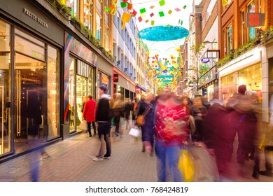 LONDON, ENGLAND - DECEMBER 2: Christmas shoppers hit the sales along Carnaby Street in London close to Christmas. On Carnaby Street, London, England. On 2nd December 2017.