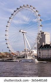 London, England - December 20, 2015 - London Eye Ferris Wheel along the Thames River in London, England.
