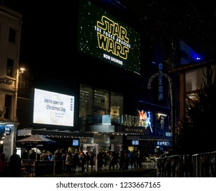 London, England - December 25th 2015: Odeon Cinema, Leicester Square at night with signs advertising Star Wars The Force Awakens movie
