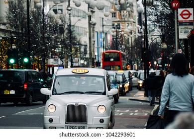 London /England - December 26 2017: Black Cabs on Oxford Street