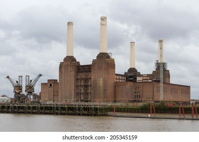 LONDON, ENGLAND - DECEMBER 28, 2011:  Silhouette of Battersea Power Station viewed from the bank of the Thames. Power Station is being redeveloped by an international consortium.