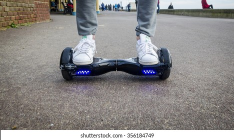 London, England - December 28, 2015: Person Riding a HoverBoard on a Public Footpath, They are now banned in all public places in the United Kingdom.