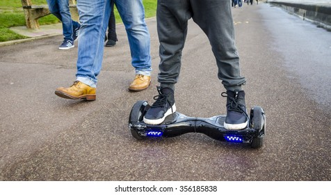 London, England - December 28, 2015: Person Riding a HoverBoard on a Public Footpath, They are now banned in all public places in the United |Kingdom.