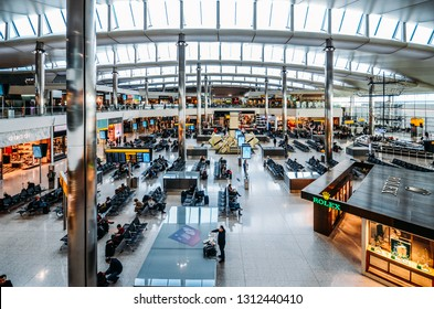 London, England, Feb 13, 2019: High perspective view of passengers and shops at departure terminal at Heathrow Terminal 3