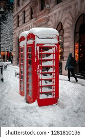 London, England - February 02, 2009: Snow Covered Telephone boxes in the City of London
