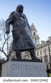 LONDON, ENGLAND - FEBRUARY 12, 2018. Churchill Statue shows Winston Churchill standing wearing a military greatcoat, Parliament Square, London, England, February 12, 2018.