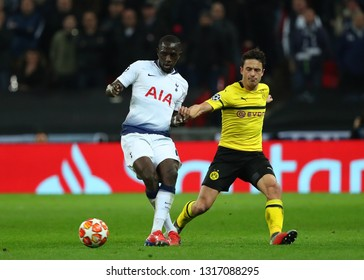 LONDON, ENGLAND - FEBRUARY 13 2019: Moussa Sissoko of Tottenham and Thomas Delaney of Dortmund compete for the ball during the Champions League match between Tottenham Hotspur and Borussia Dortmund