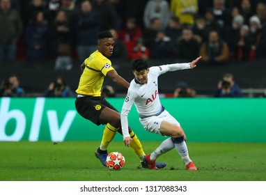 LONDON, ENGLAND - FEBRUARY 13 2019: Dan-Axel Zagadou of Dortmund and Son Heung-Min of Tottenham during the Champions League match between Tottenham Hotspur and Borussia Dortmund at Wembley Stadium